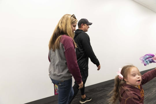 Danny Gonzales and his family heads to a news conference for the ASU defensive coordinator.