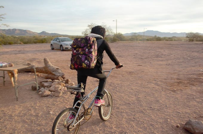 Third-grader Daphnie Segundo rides her bike to school from her home in Sells on the Tohono O'odham reservation.