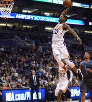 Dec 13, 2018; Phoenix, AZ, USA; Phoenix Suns forward Josh Jackson (20) dunks against the Dallas Mavericks during the first half at Talking Stick Resort Arena. Mandatory Credit: Joe Camporeale-USA TODAY Sports