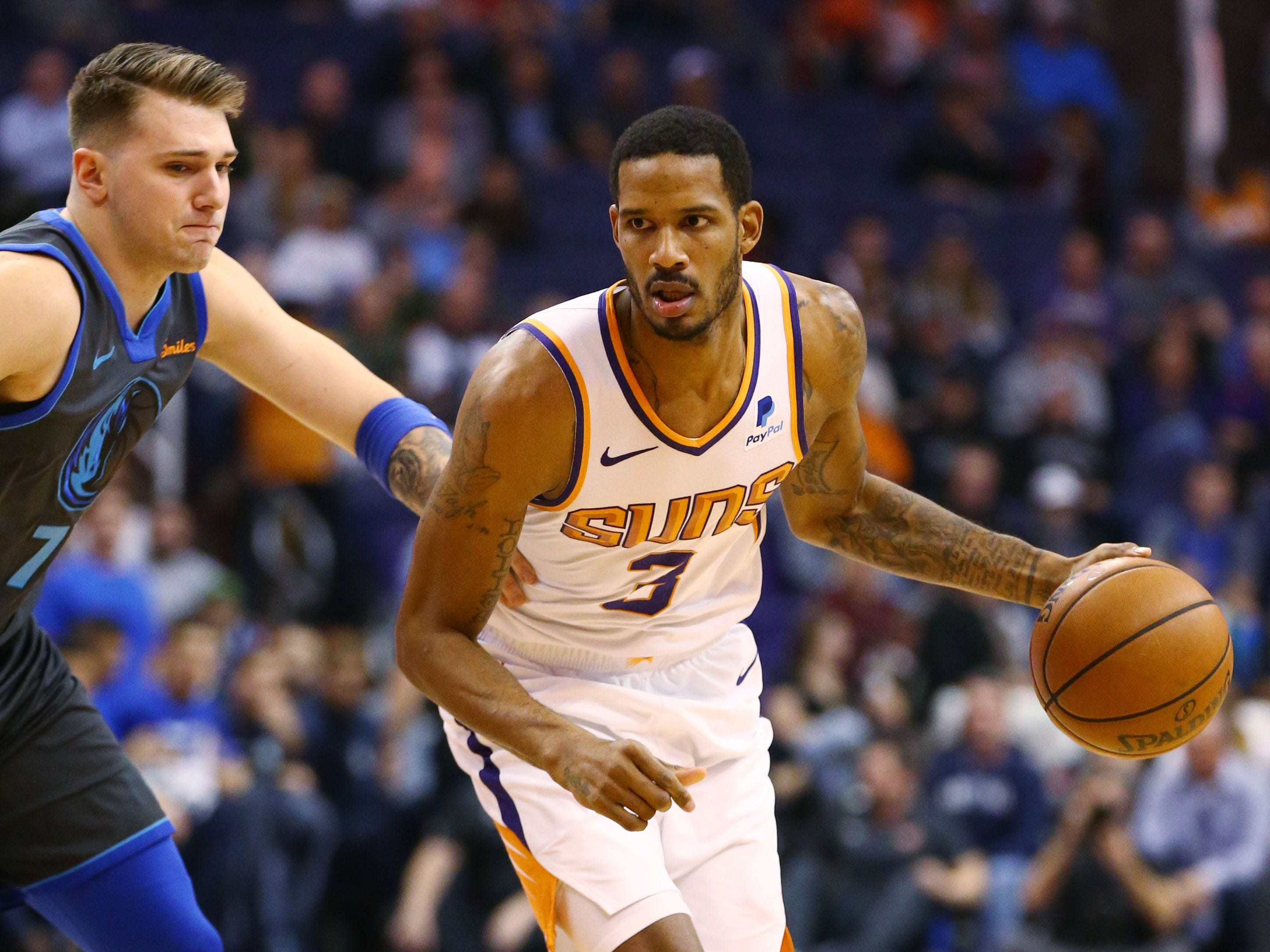 Phoenix Suns forward Trevor Ariza drives to the lane against the Dallas Mavericks' Dwight Powell  during a game on Dec. 13 at Talking Stick Resort Arena.
