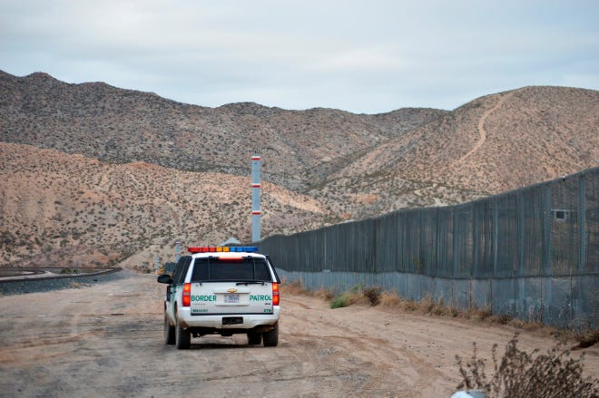 FILE - In this Jan. 4, 2016, file photo, a U.S. Border Patrol agent patrols Sunland Park along the U.S.-Mexico border next to Ciudad Juarez. A 7-year-old girl who had crossed the U.S.-Mexico border with her father, died after being taken into the custody of the U.S. Border Patrol, federal immigration authorities confirmed Thursday, Dec. 13. (AP Photo/Russell Contreras, File)