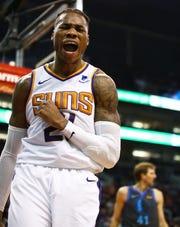 Suns center Richaun Holmes celebrates after making a basket against the Mavericks during a game Dec. 13 at Talking Stick Resort Arena.