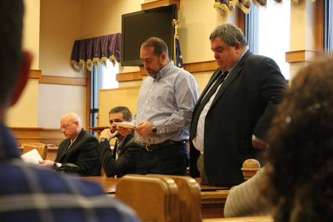 Thomas Owens, owner of Tom's Toys, addresses the court prior to being sentenced to three years in prison. Owens is joined by his attorney, Tom DeBacco, right, in Ottawa County Common Pleas Court on Friday.