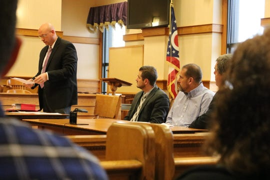 Ottawa County Prosecutor James VanEerten, left, addresses the court during the sentencing hearing of Thomas Owens, right, owner of Tom's Toys, in Ottawa County Common Pleas Court on Friday. Owens was sentenced to three years in prison.