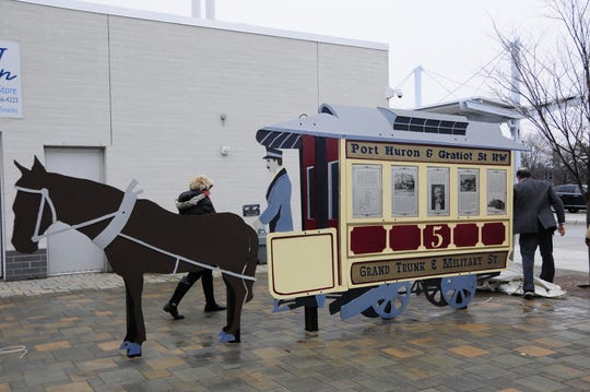 A sculpture installed at the Blue Water Area Transit bus center depicts a horse-drawn streetcar.