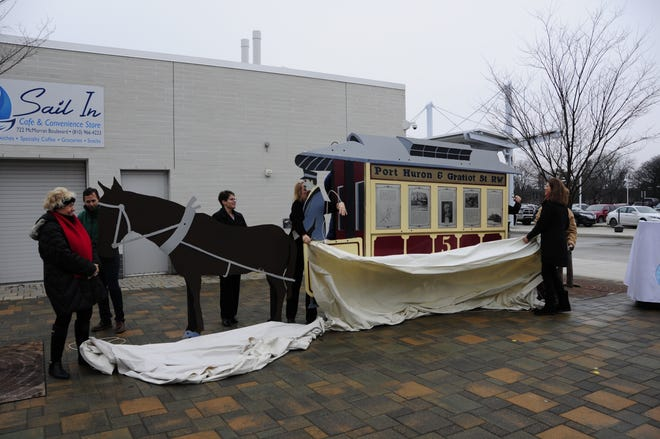 The drapes fall as a statue honoring William Pitt Edison is unveiled Friday, Dec. 14, 2018.