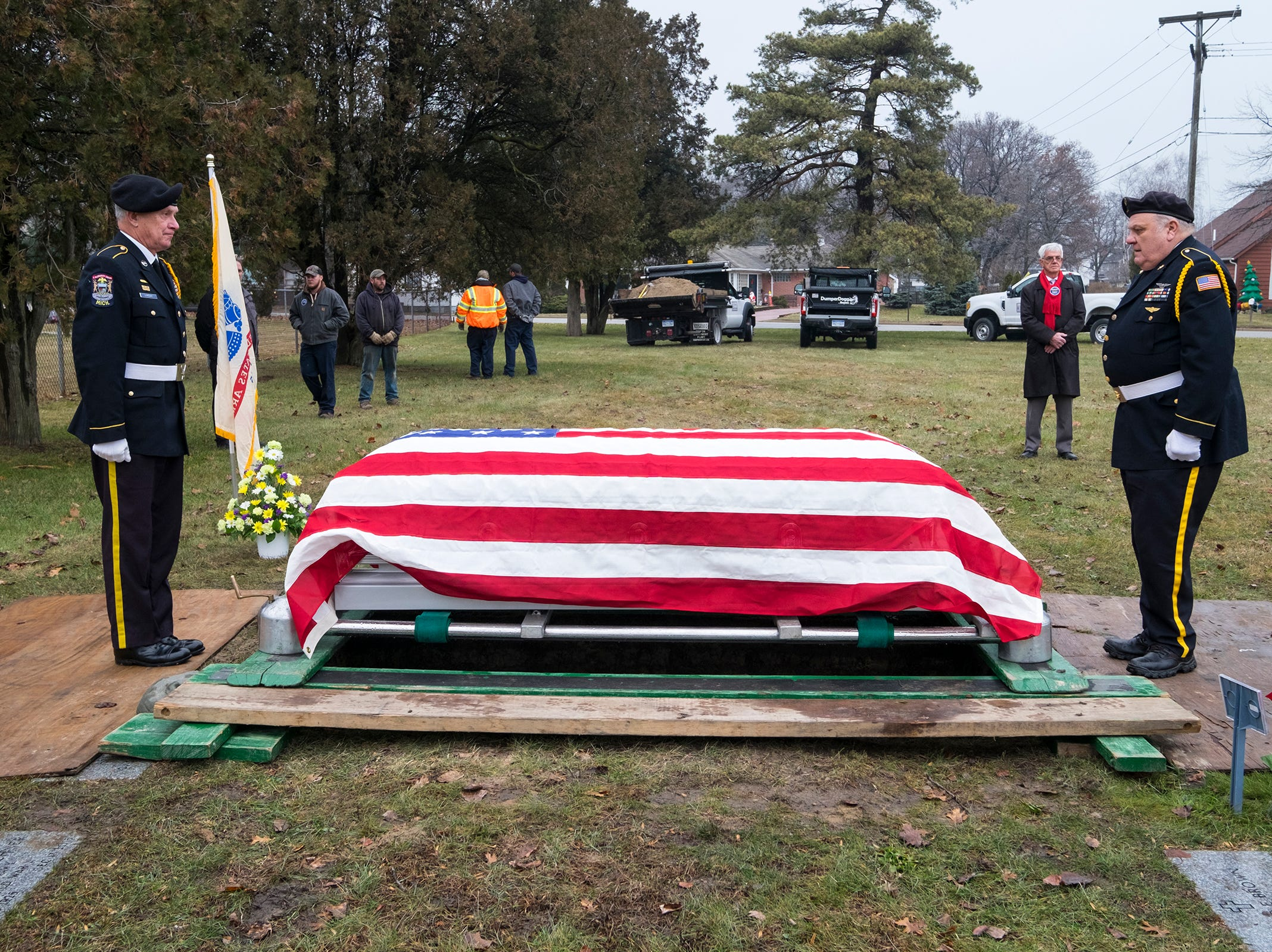St. Clair County Allied Veterans Council members Bill Livesay, left, and Dave Robinson stand at attention at either end of the casket of Joseph A. Humphries during his funeral Friday, Dec. 14, 2018 at Allied Veterans Cemetery in Fort Gratiot.