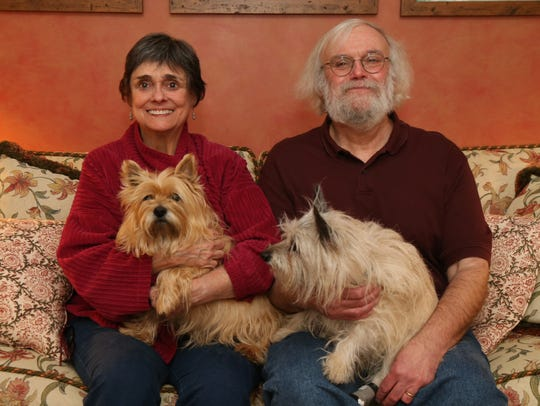Cynthia Koch and Eliot Werner with their dogs Goldie and Duncan at their home in Clinton Coners on December 13, 2018. Werner, a publisher of academic works in social science was convinced to publish a volume on FDR by his wife Cynthia who was the director of the FDR Library & Museum until 2011.