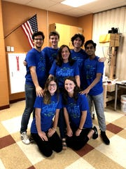 The AquaPals, an Arlington High School science research team. Teammates Spencer Koonin, Tyler Locke, Jacob Gaines, Krishna Koka (from top left); Emme Magliato, and Shannon Gibson (from bottom left), along with their advisor Maribel Pregnall (center).
