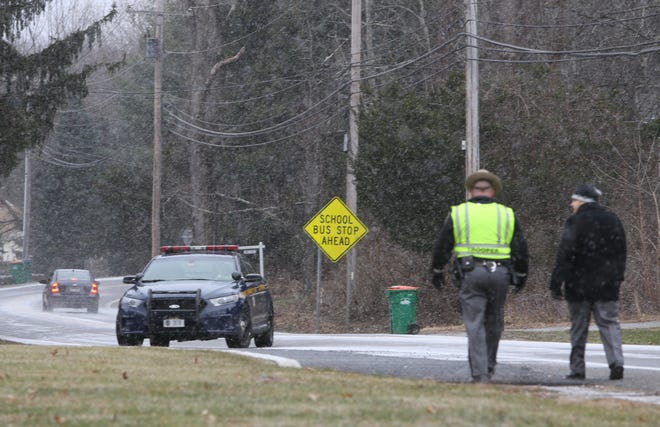 Police monitor the intersection of Route 82 and and Clove Branch roads in East Fishkill on December 13, 2018.