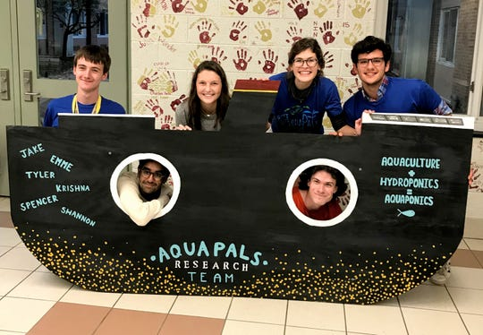 The AquaPals, an Arlington High School science research team, present their findings at an open house at school in October 2018.