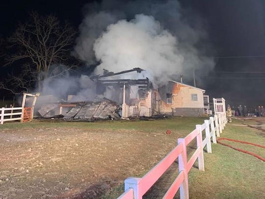 A 3-story log house, home to two Amish families, burned Thursday evening in Path Valley.