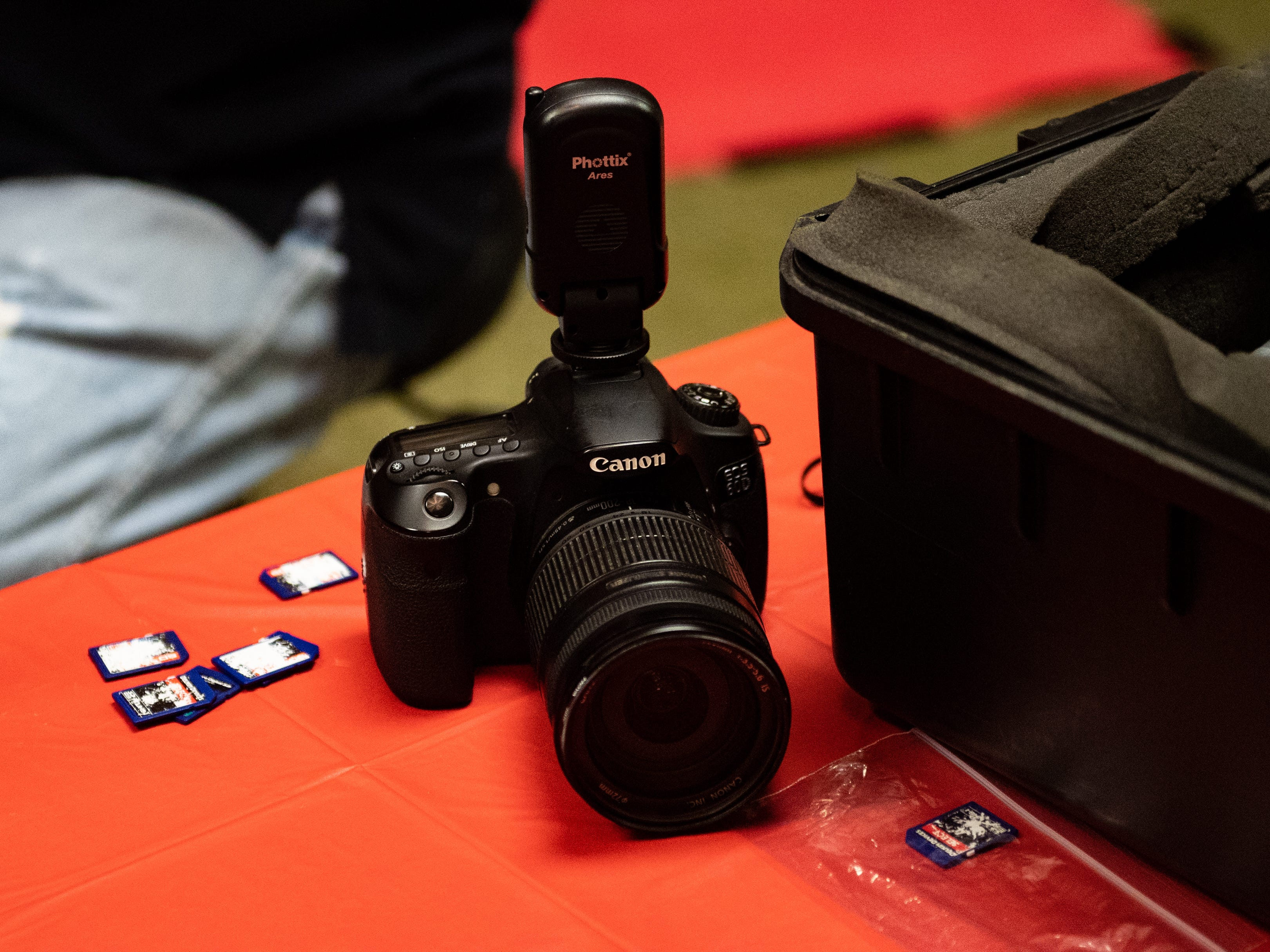 The photographers use multiple SD cards while taking photos to ensure pictures can be printed as fast as possible during the Annual Evening with Santa at the Lincoln Engine Company, December 13, 2018.