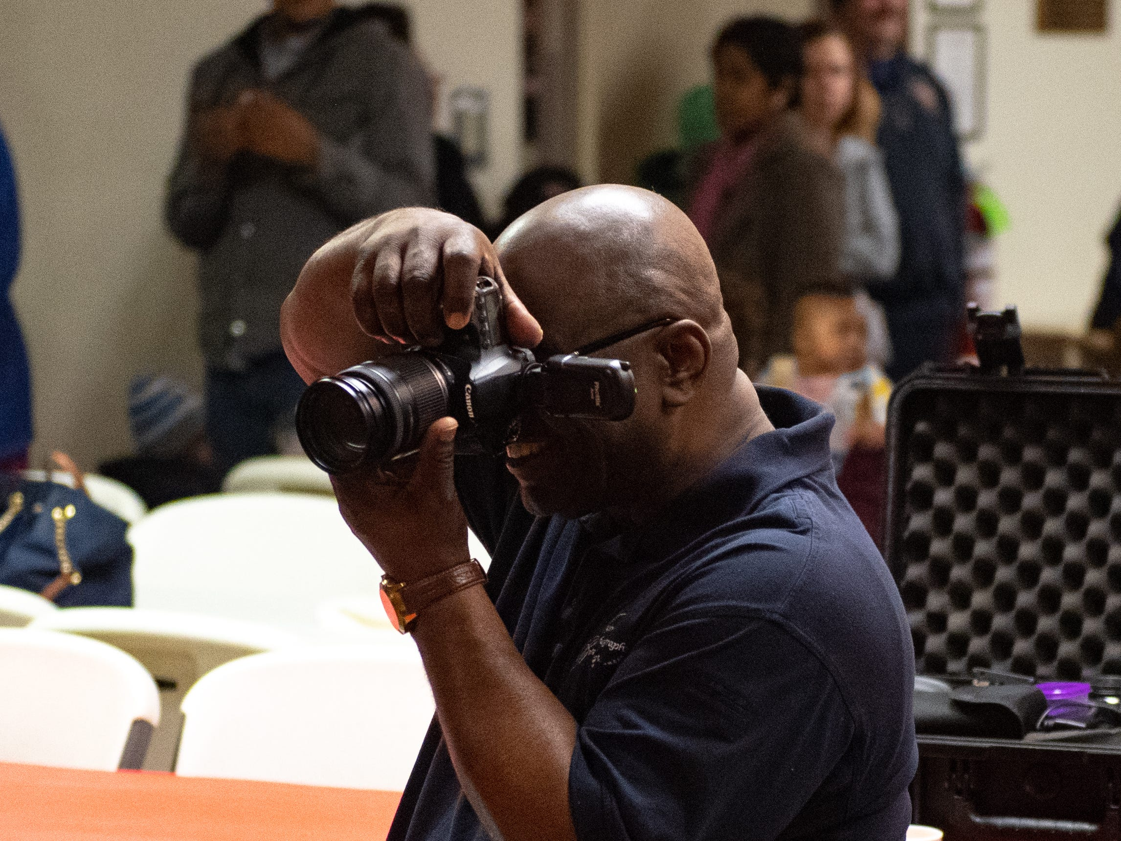 Photographer Lawrence Tyler took pictures of children with Santa Claus during the Annual Evening with Santa at the Lincoln Engine Company, December 13, 2018.