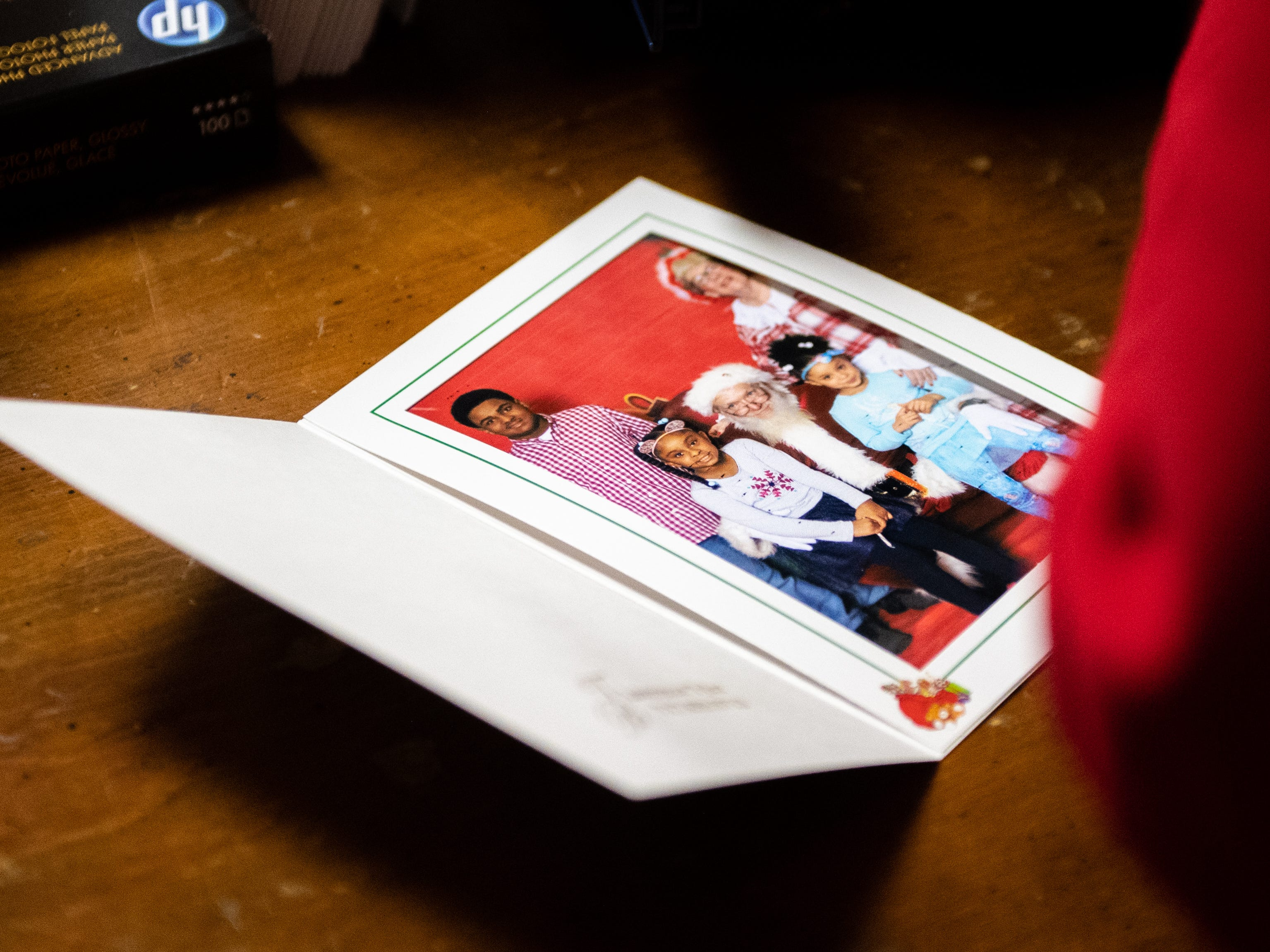 Once the picture is taken, the images are printed out and given to families within minutes during the Annual Evening with Santa, December 13, 2018.