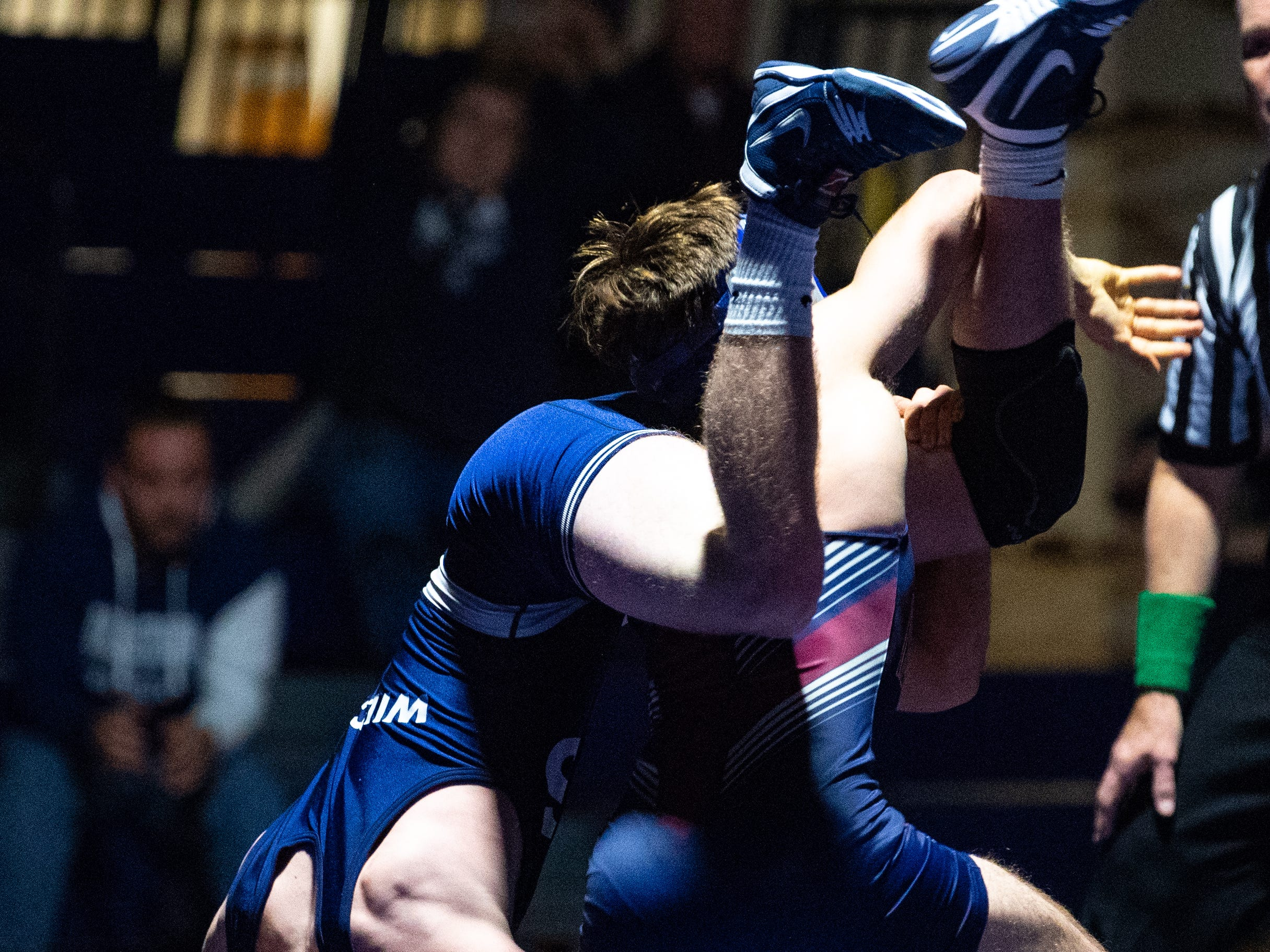 New Oxford's Brennan Romanoff puts down Dallastown's Sam Druck during the YAIAA Division I wrestling match, December 13, 2018. The Wildcats defeated the Colonials 40-20.