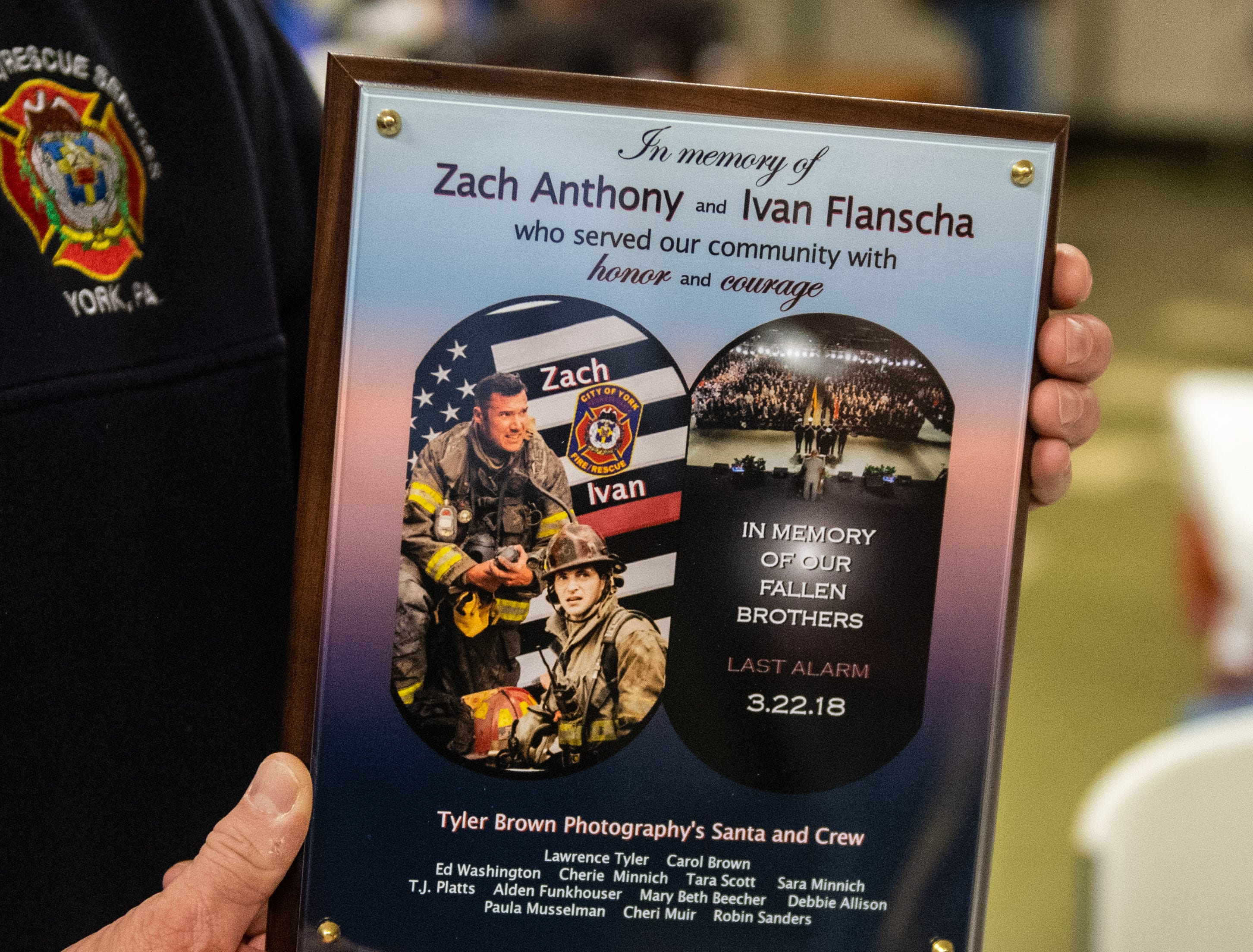They were presented with a plaque created by Tyler Brown Photography honoring their fallen brothers, Ivan Flanscha and Zachary Anthony.