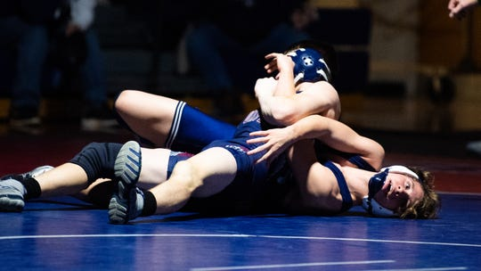 New Oxford's Jared Bair keeps Dallastown's Brooks Gable down during the YAIAA Division I wrestling match, December 13, 2018. The Wildcats defeated the Colonials 40-20.