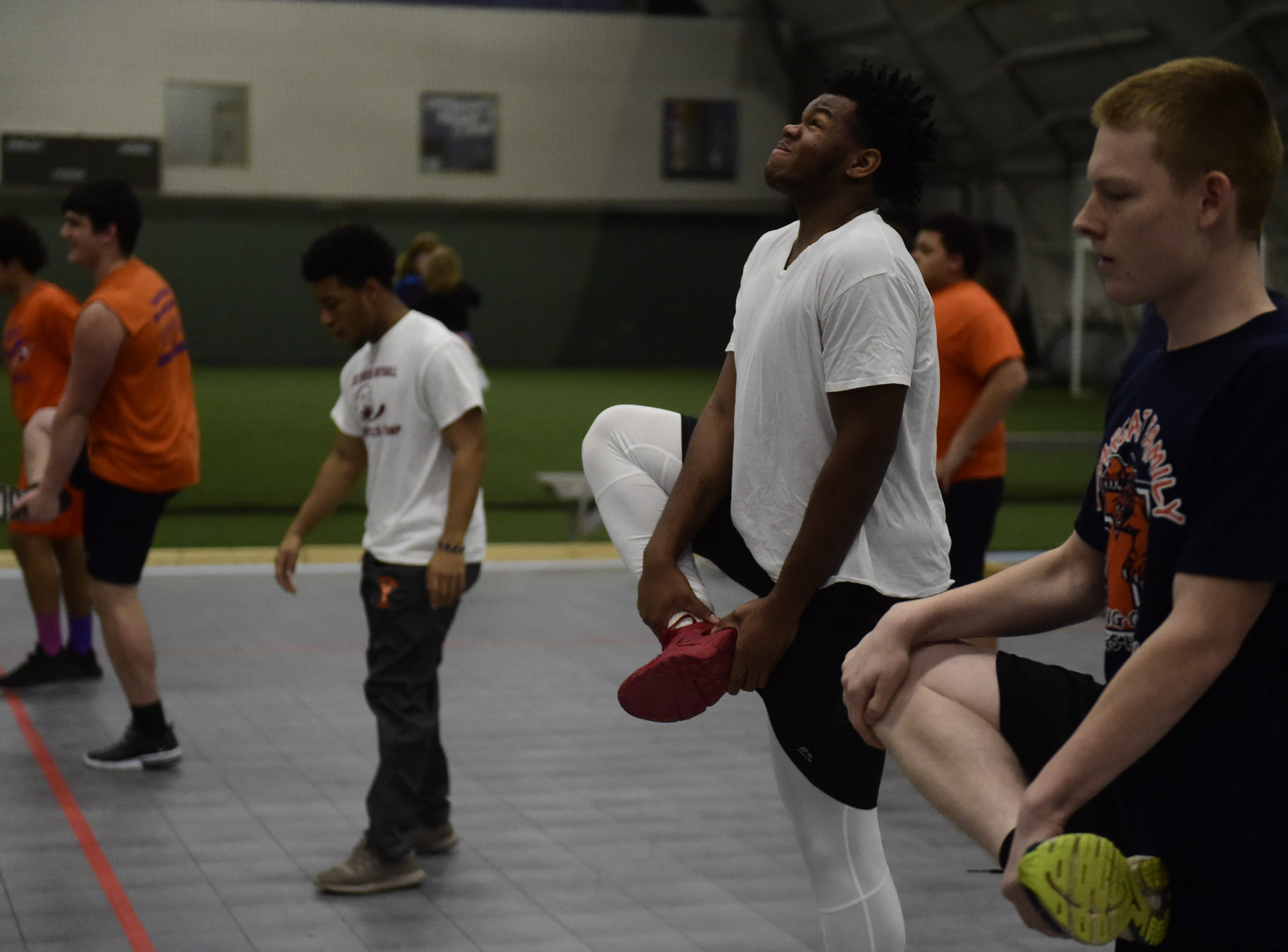 York High football players stretch during offseason workouts Thursday, Dec. 13, 2018 at Ballyhoo Sports Academy at Heritage Hills.