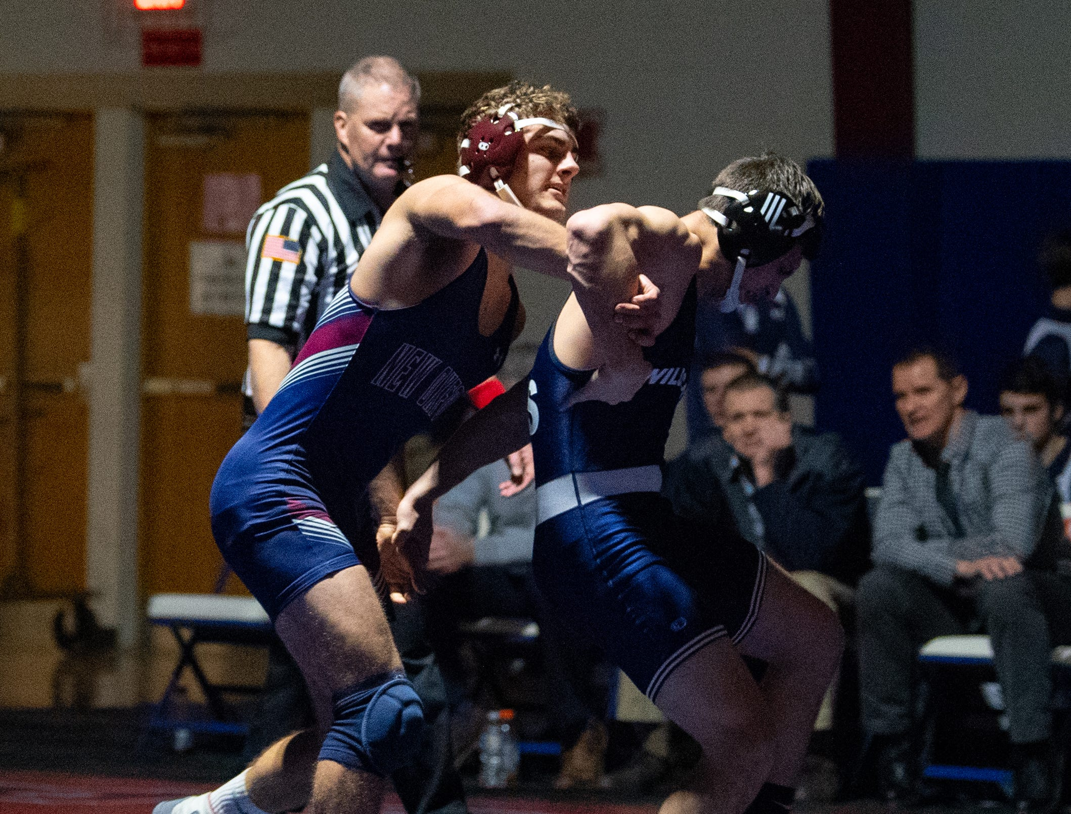 New Oxford's Luke Lardarello grabs Dallastown's Franklin Klinger during the YAIAA Division I wrestling match, December 13, 2018. The Wildcats defeated the Colonials 40-20.