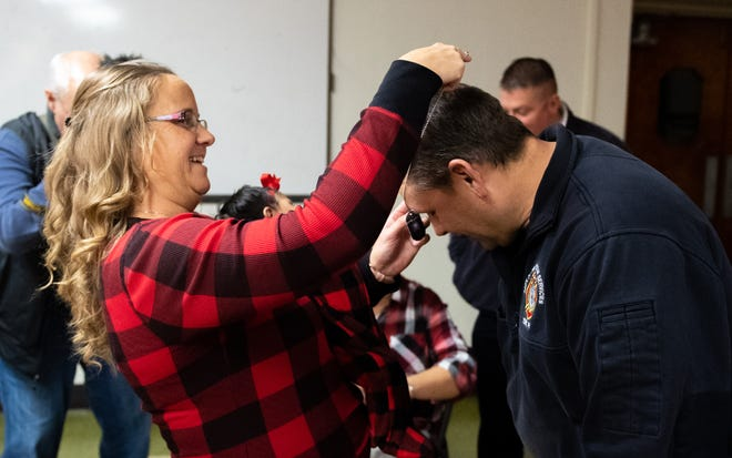The dog tags were presented to each and every firefighter by family, friends and members of the community. Tara Scott was among the first to bestow the tags, December, 13, 2018.