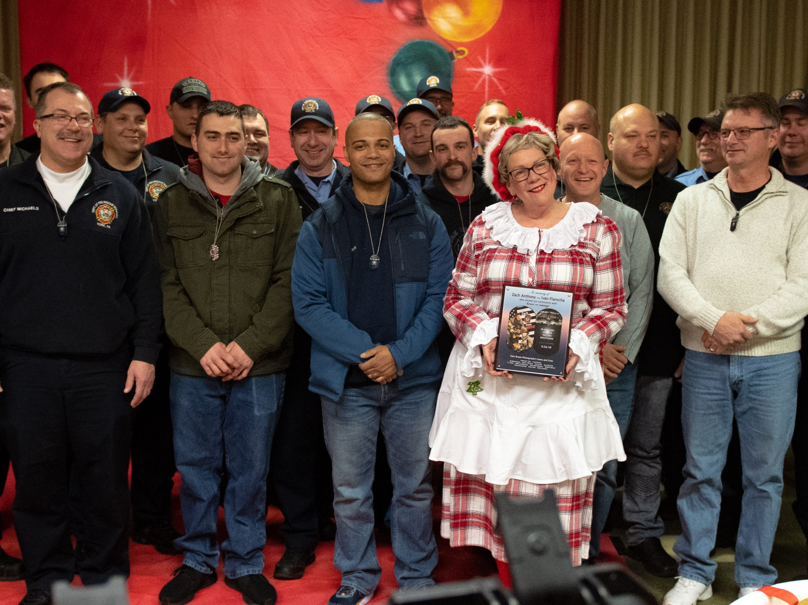 After all firefighters received their dog tags, Everyone posed for a picture, December 13, 2018.