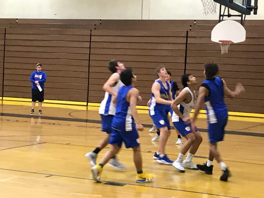 The Reed boys basketball team practices Thursday at Reed.