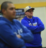 Reed basketball head coach Keegan Bosier, right, watches a drill during practice in Sparks on Dec. 13.