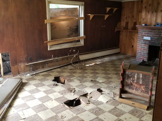 "Before picture of the interior of a ""zombie home"" that vocational students  from BOCES are helping to rehabilitate."