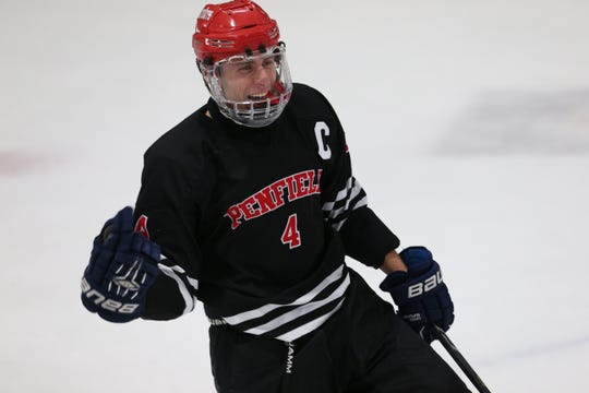 Penfield's Jack Schlifke celebrates his second goal of the night in a 2-2 tie against Fairport on Dec. 13.