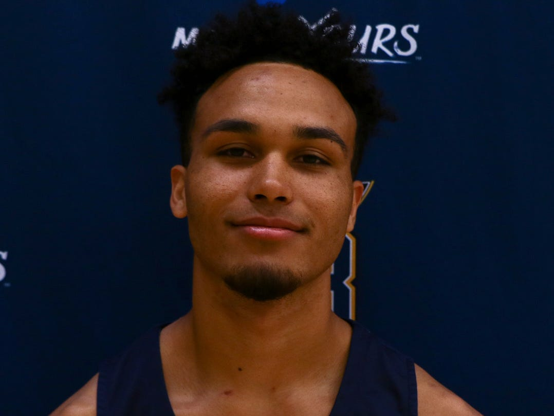 Enterprise grad Tyler Green poses for a photo as part of the Montana State University Billings Yellowjackets.