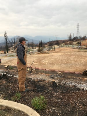 Dan Kissick, looking at the now-cleared spot where his home was located before it was destroyed by the Carr Fire in July 2018. He visits the site daily to take down burned trees bit-by-bit and collect his mail.