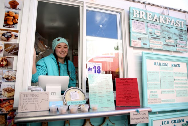 Street Sweets server, Cammie Stice, looks out the window of her food truck on opening day of The Yard Food Park in Salem on Thursday, Dec. 13, 2018.