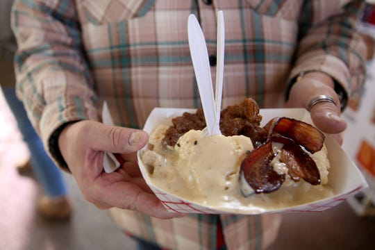 Loaded biscuits and gravy are served from Bite Me Foods food truck on opening day of The Yard Food Park in Salem on Thursday, Dec. 13, 2018.