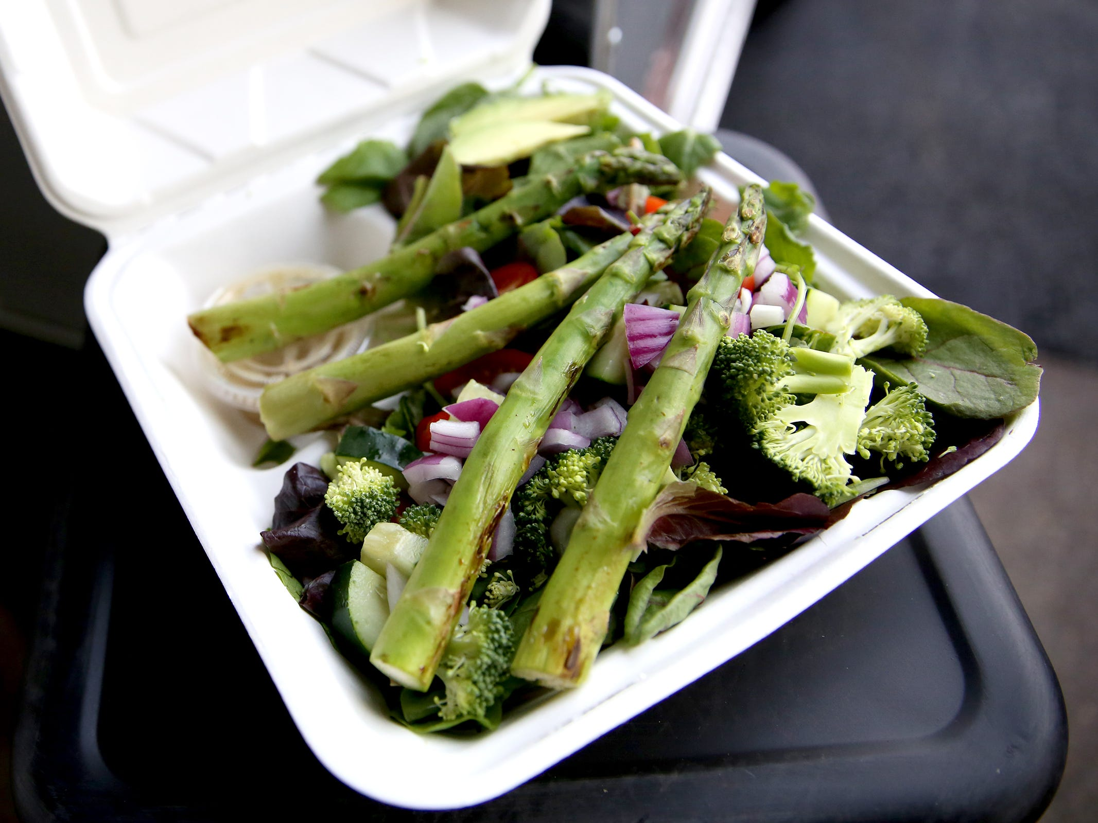 """An """"everything salad"""" is served from Bullet Proof Meals on opening day of The Yard Food Park in Salem on Thursday, Dec. 13, 2018."""