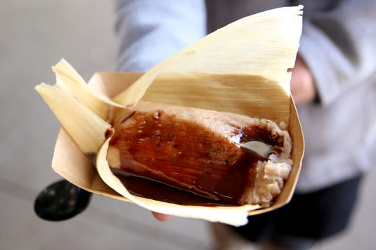 Yolandas Tamales serves tamale-based deserts on the opening day of The Yard Food Park in Salem on Dec. 13, 2018.