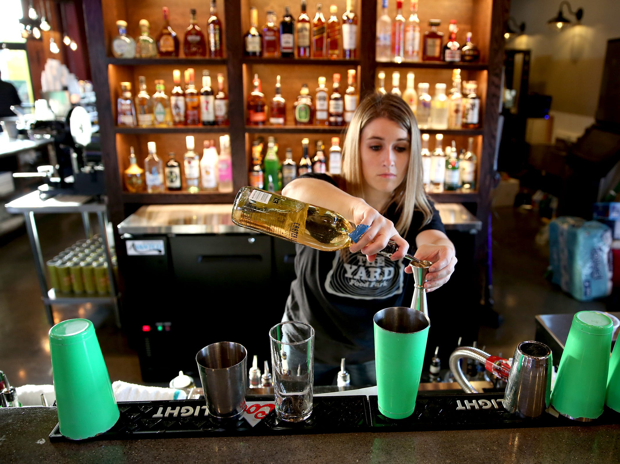 Bartender Brianne Taylor makes a cocktail on opening day of The Yard Food Park in Salem on Thursday, Dec. 13, 2018.