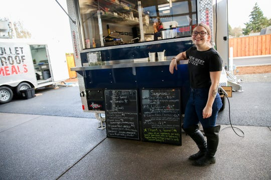 Brianne Taylor, owner of Homegrown Grub, poses in front of her food truck on opening day of The Yard Food Park in Salem on Thursday, Dec. 13, 2018.