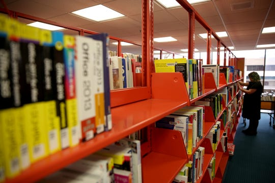 Books are rearranged on the first floor of the Salem Public Library on Friday, Dec. 14, 2018.