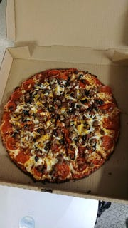 "The ""Big Brutus"" -  topped with ground beef, bacon, pepperoni, three kinds of cheese, and vegetables - at CR Snell's Pizza."