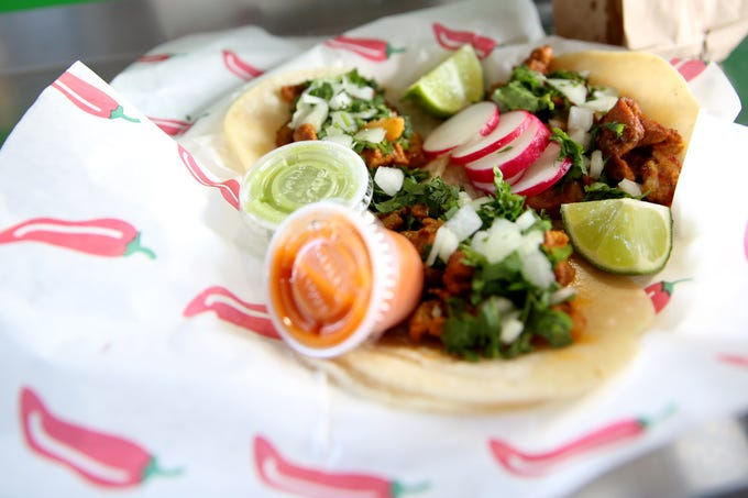 Al pastor tacos, from Pacos Mexican Food food truck, are pictured on opening day of The Yard Food Park in Salem on Thursday, Dec. 13, 2018.