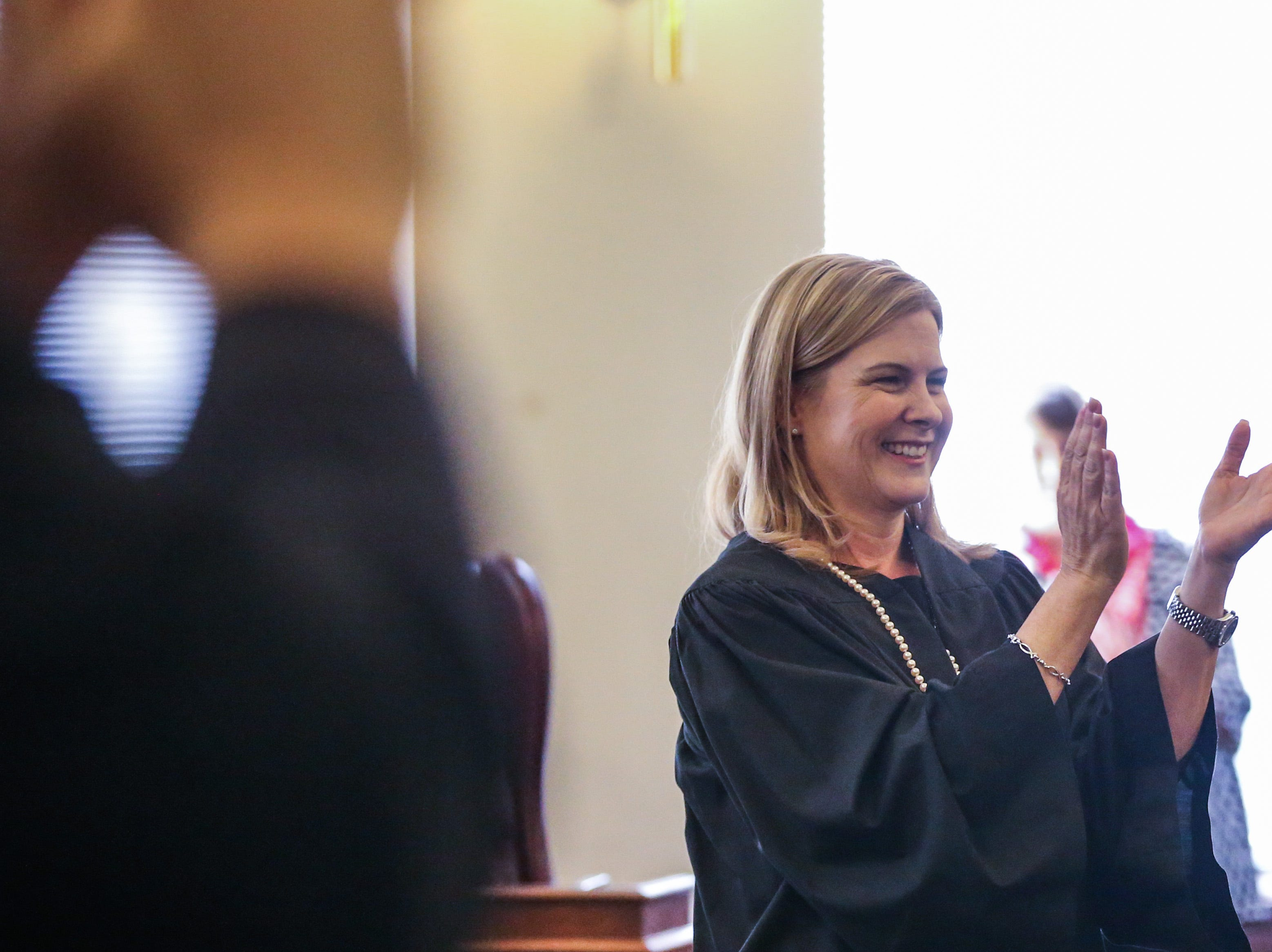Judge Carmen Dusek applauses Justice during the swearing in ceremony Friday, Dec. 14, 2018, at Tom Green Courthouse.