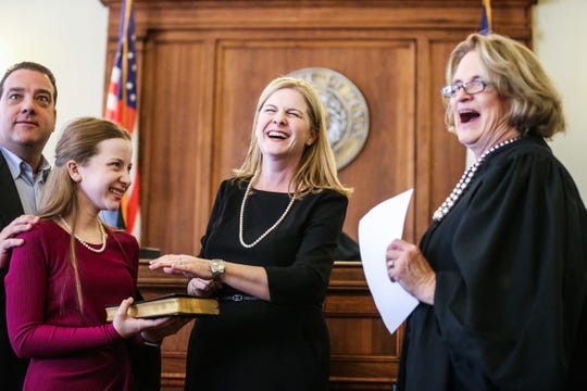 Justice Barbara Walther, right, laughs with Carmen Dusek and her family as Dusek is sworn in as 51st District Court judge Friday, Dec. 14, 2018, at Tom Green Courthouse.