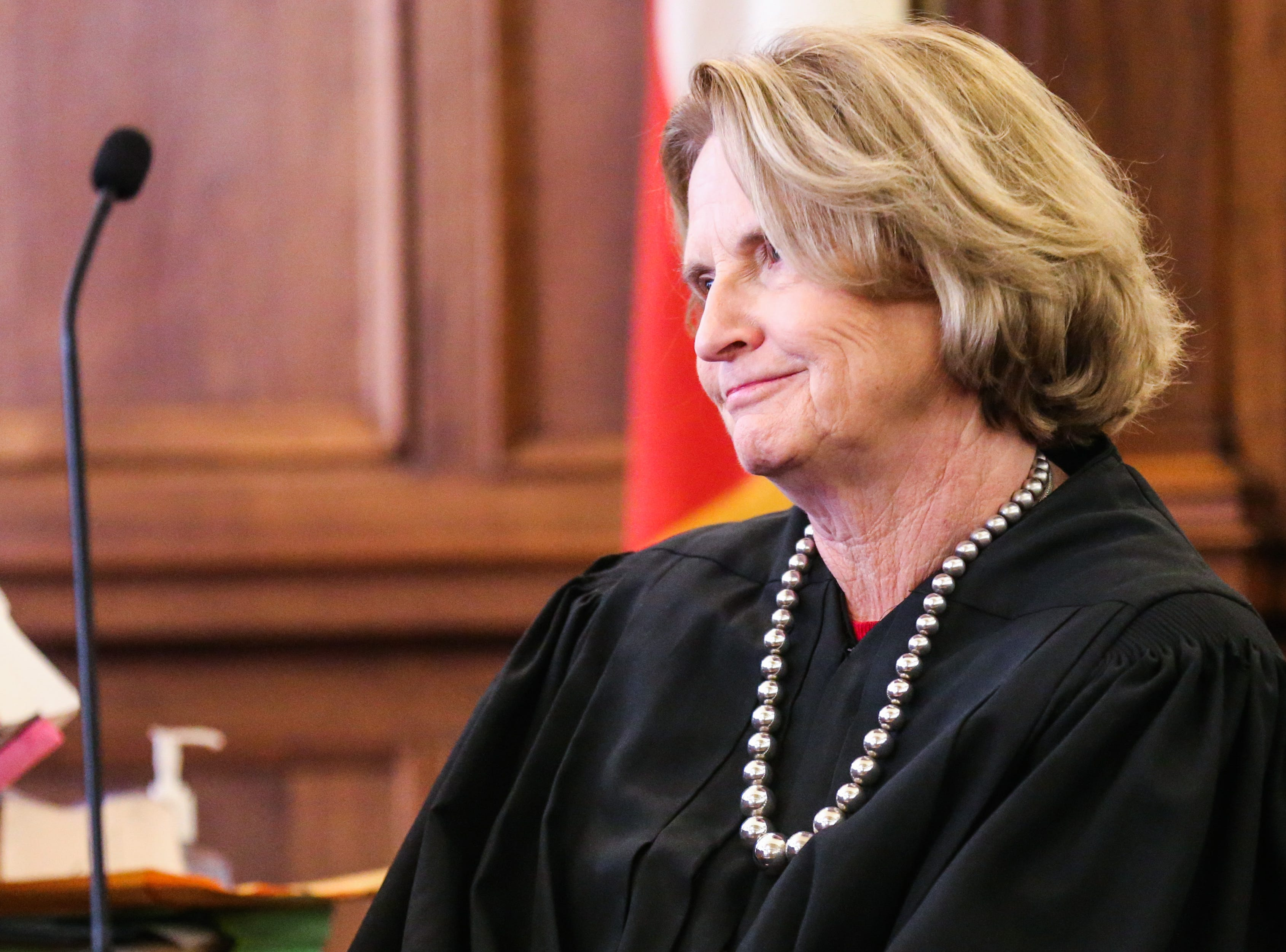 Justice Barbara Walther listens to Carmen Dusek speak during the swearing in ceremony Friday, Dec. 14, 2018, at Tom Green Courthouse.