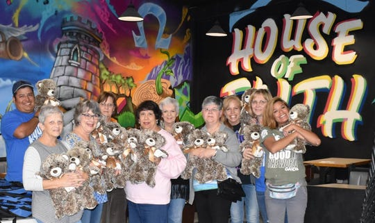 Members of Xi Alpha Nu present 29 stuffed bears to the staff at House of Faith in San Angelo.