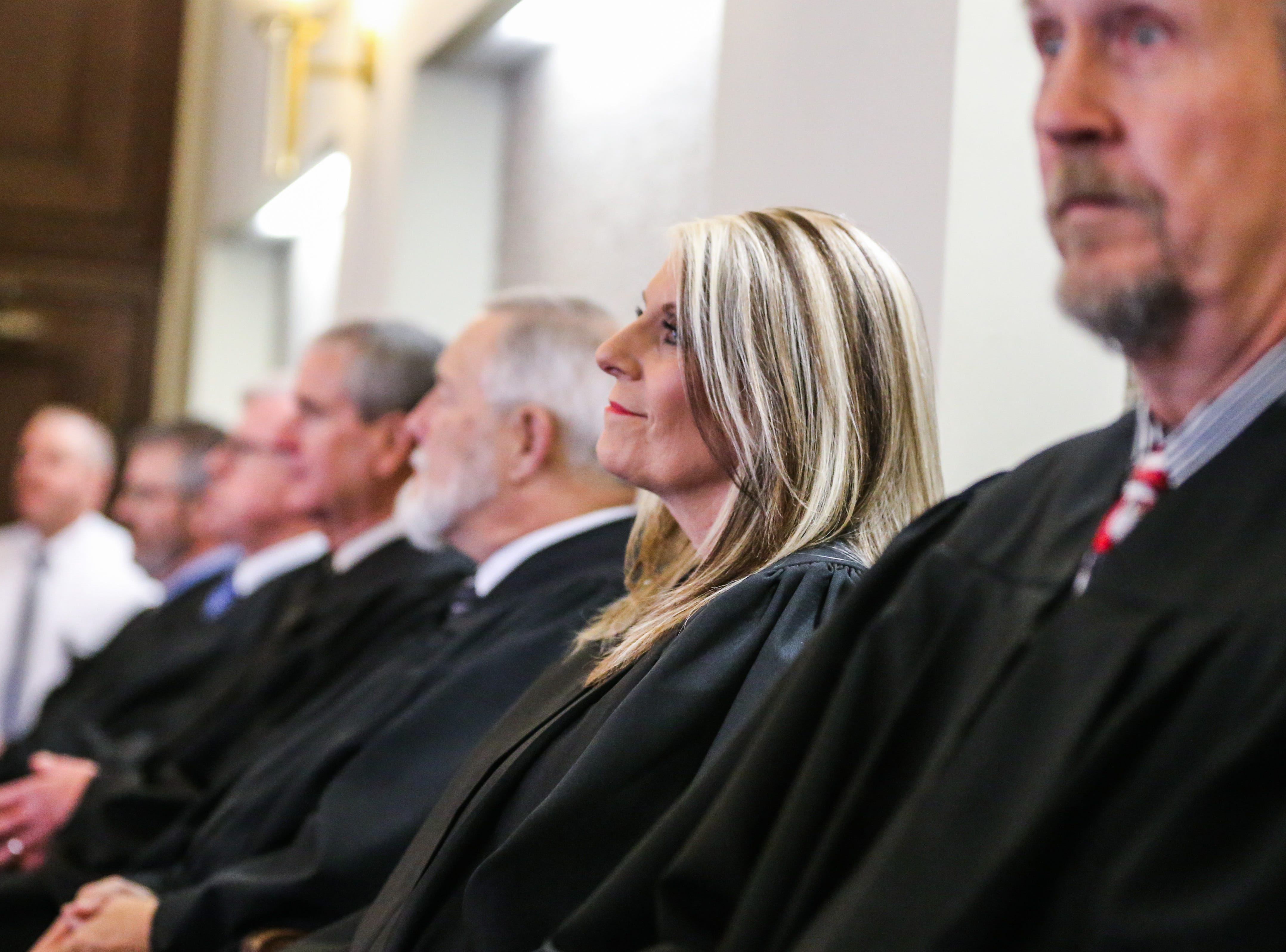 Judges look on during the ceremony to swear in Carmen Dusek as 51st District Court judge Friday, Dec. 14, 2018, at Tom Green Courthouse.