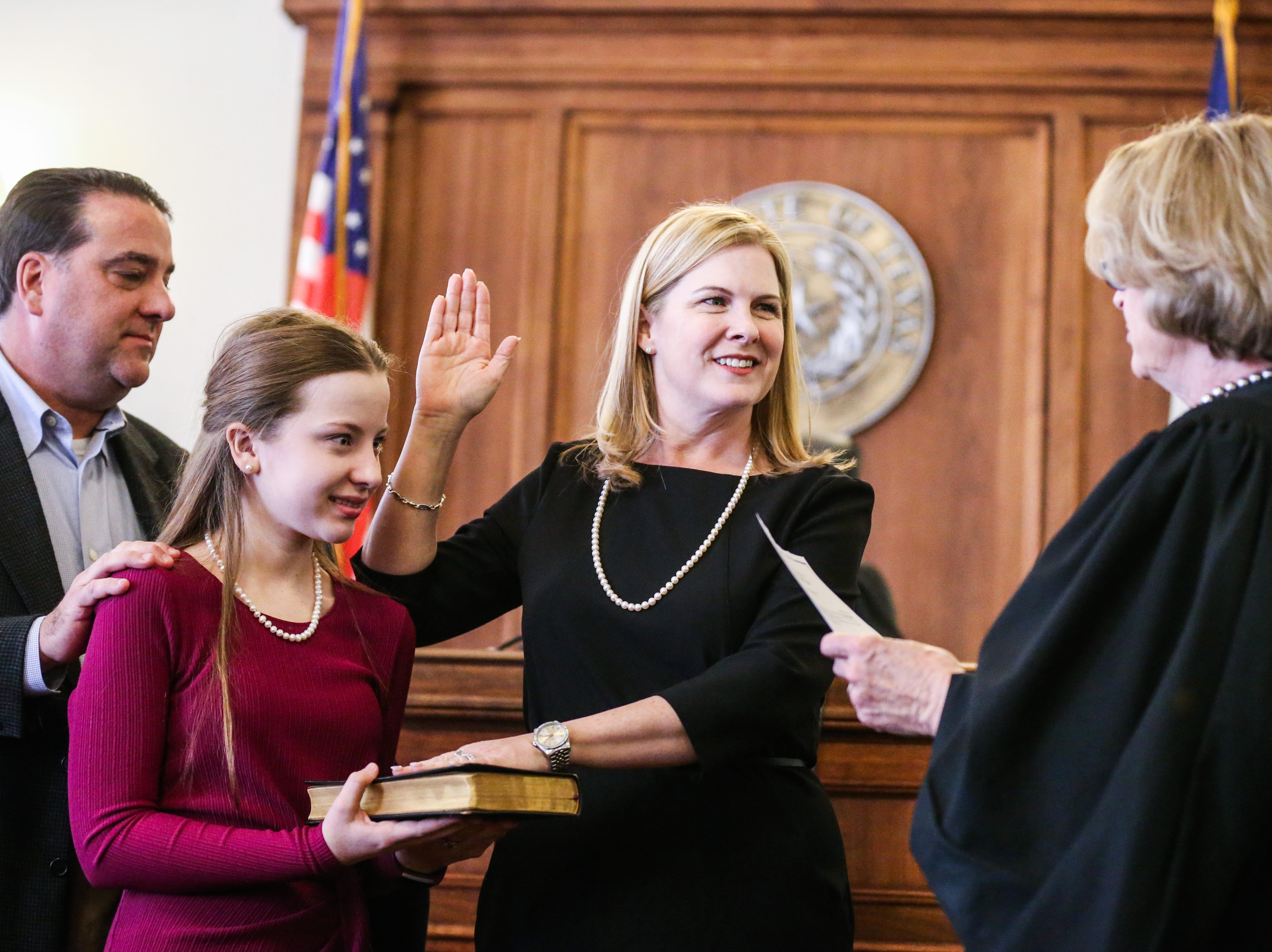 Carmen Dusek is sworn in as 51st District Court judge Friday, Dec. 14, 2018, at Tom Green Courthouse.