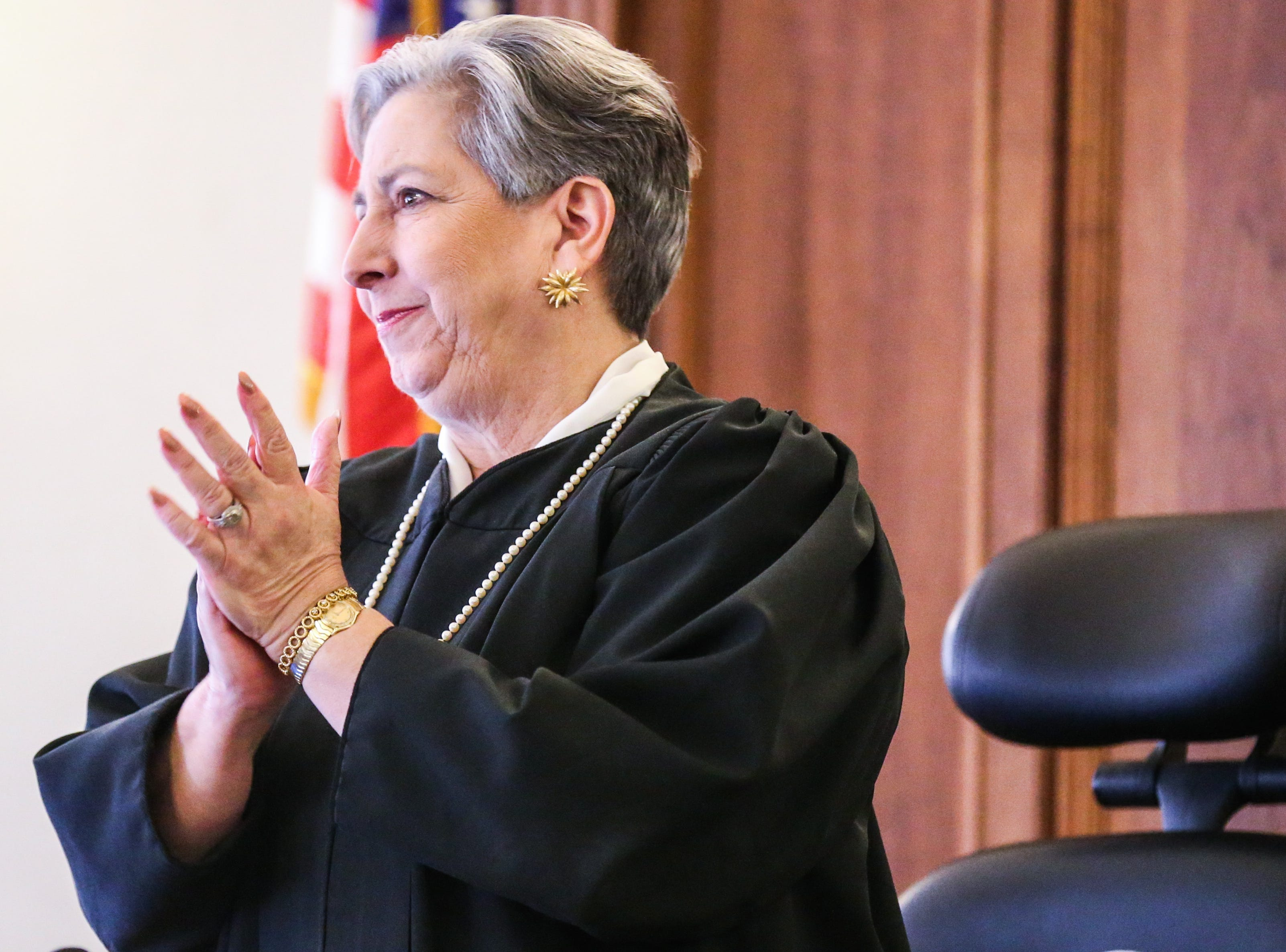 Justice Marilyn Aboussie stands to applause Carmen Dusek at the concluding on the swearing in ceremony Friday, Dec. 14, 2018, at Tom Green Courthouse.
