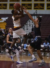 Salisbury University Sophomore Guard Gary Briddell with the basket against Wesley on Sunday, Dec. 9, 2018.