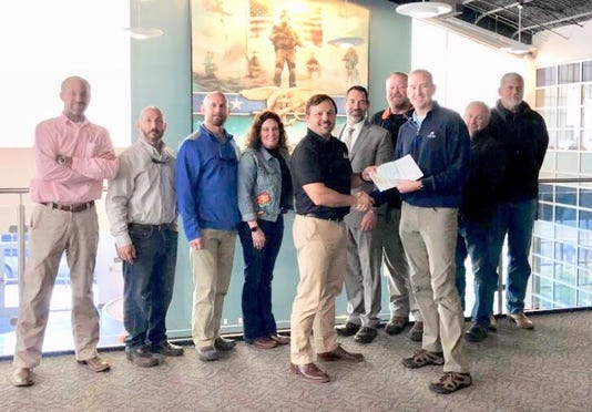 Presenting The 111075 28 Check To The Navy Seal Foundation At The Seal Heritage Center Jeblc In Virginia Beach On Nov 20